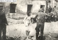A Jewish woman fighter who fell captive to the Germans in the Warsaw ghetto uprising, ordered to strip, to prove that no weapons are concealed on her person. Photographed during the suppression of the Warsaw ghetto uprising in April - May 1943. [[MORE]]texanwill:Source-Ghetto Fighters House Archives, document #2913