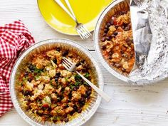 HEALTHY GRILLED CHICKEN-AND-RICE FOIL PACKS (makes 4): 4 boneless, skinless chicken thighs 1/2-in chunks, 15-oz can black beans-drained rinsed, 1 cup converted rice, 1 cup salsa, 2 tbsp pickled jalapeno slices-finely chopped, 1 tbsp tomato paste, 1 tsp chili powder, 1/4 tsp turmeric, Kosher salt, 2 cups low-sodium chicken broth, 2 scallions-thinly sliced.
