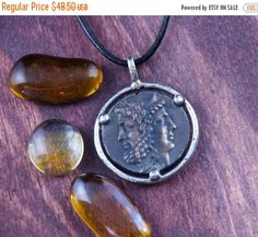 ON SALE Ancient Coin Large Size Pendant - Zeus & Hera - Sterling Silver by CoinJewelrySilver on Etsy https://www.etsy.com/listing/246697105/on-sale-ancient-coin-large-size-pendant