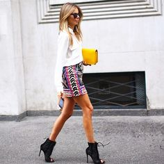 You can never go wrong with a crisp white button down and patterned skirt combination. // #StreetStyle #MFW