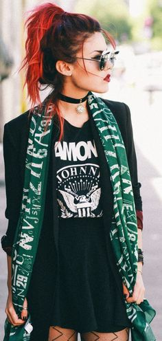 Punk: The long blazer and patterned tights are on trend, and I'm liking a graphic tshirt under it and that choker! She looks pretty darn cool. With some combat boots? Yessss.