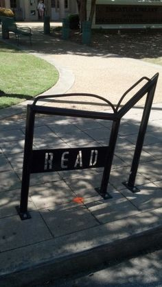Book-shaped bike rack in front of the downtown Decatur branch of DeKalb County Public Library (GA). Photo credit: Decatur Metro, Eye on the Street.