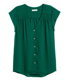 Check this out! CONSCIOUS. V-neck blouse in airy, woven crêpe fabric with pin-tucks at shoulders, cap sleeves, and pearlescent buttons at front. Made partly from recycled polyester. - Visit hm.com to see more.