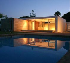 Casa Sandra in Spain by HB Design Pte Ltd.-a timber clad box contains bedrooms & a white painted wall element defines the living/dining area. See more:  http://www.archello.com/en/project/casa-sandra