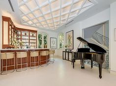 Grand piano next to the bar for some classy entertainment. #BeverlyHills #LA eleganthomes4you.com