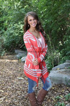 The Pink Lily Boutique - A Turning Point Fringe Coral Cardigan, $42.00 (http://thepinklilyboutique.com/a-turning-point-fringe-coral-cardigan/)