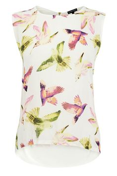 A beautiful bird-printed sleeveless top. Featuring a gold zip to the back, and a drop-curved hem.