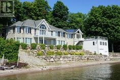 Waterfront mansion with dual boat garage.