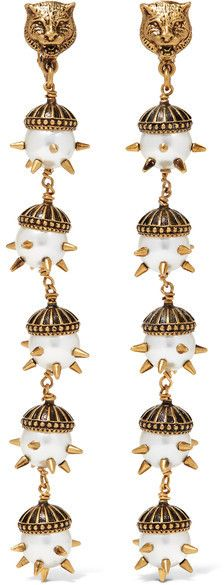 Part of Gucci's Pre-Fall '16 collection, these drop earrings are cast from burnished gold-plated brass. They're strung with five tiers of spike-encrusted faux pearls that hang from the label's signature tiger head. Pair yours with a pussy-bow blouse.
