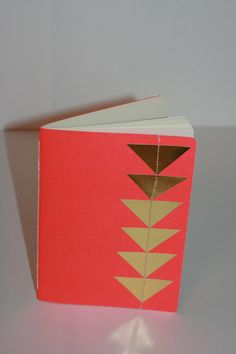 Rad little notebooks with gold foil details. Could do the same with paint chips... #DIY