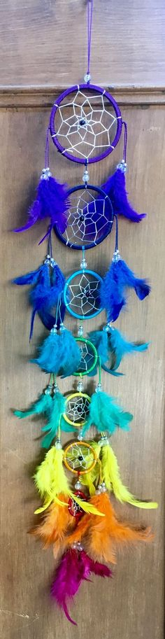 Seven tier chakra dreamcatcher with feathers.