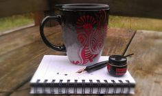 Grey to Black ombre mug with red henna swirl by SureFootedDreamer