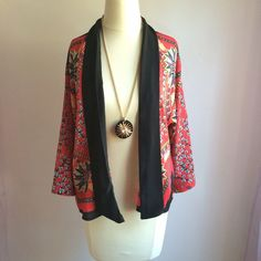 """Red Floral Kimono Jacket OFFERS WELCOME. PLEASE USE THE OFFER BUTTON. I DO NOT NEGOTIATE PRICE IN THE COMMENTS. NO TRADES. Relaxed kimono jacket with the most gorgeous print. Length is 24"""". 22"""" across at bustline. Sleeves are 16"""" long. 100% polyester. Unlined. No closures. EUC, like new. Size small. Love Tree Jackets & Coats"""