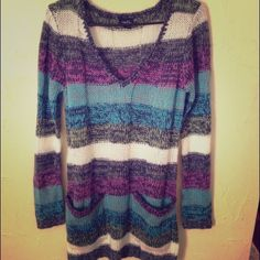 Rue 21 vneck striped sweater Rue 21 vneck striped sweater. Size large. Gray, green, blue, white and pink. Never worn. New without tags. 2 large front pockets. 100% acrylic. Rue 21 Sweaters V-Necks