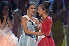 Miss Philippines Janine Tugonon (center) congratulates Miss USA Olivia Culpo after Culpo was named Miss Universe 2012 during the Miss Universe Pageant in Las Vegas, Nevada on Thursday (Manila time). Tugonon joins former Miss Universe candidates Venus Raj and Shamcey Supsup to have made it in the top five in the last three years. PHOTO BY JOE KLAMAR, AFP