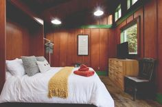 This brand-new bed in this cozy, cabin-like studio is calling! #cabin #cabinlife #studio #airbnb #travel #portland #oregon #pdx #whitespiderpdx #design #interiordesign #interiors #woodpanels #smallspaces #cozy #dscolor