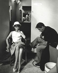 """The actor William Holden photographed with the actress Audrey Hepburn by Pierluigi Praturlon in his dressing room at the Studio de Boulogne in Paris (France), during a break in the filming of """"Paris - When It Sizzles"""", in July 1962."""