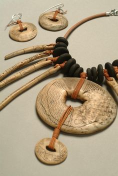 Necklace & Earrings ~ Luann Udell ~ Luann is a fiber, polymer and mixed media artist, who recreates old artifacts using polymer clay. This necklace is a great example, where her own handmade pieces are made to look like real fossil ivory. Jewelry Crafts, Jewelry Art, Beaded Jewelry, Handmade Jewelry, Jewelry Design, Jewellery, Yoga Jewelry, Punk Jewelry, Polymer Clay Necklace