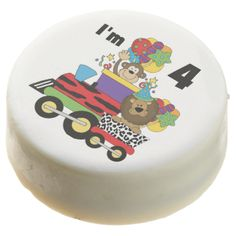 Jungle Train 4th Birthday dipped Oreos and Oreo pops, a sweet treat for the birthday child and the guests at the celebration, also makes a fantastic take home party favor! Features a jungle animals print train locomotive and car, a monkey, lion in party hat, bunch of birthday balloons, and text that reads I'm 4! #kids #birthdays #jungle #animals #train #lion #monkey #fourth #birthday #four #4th #birthday #locomotive