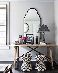 Glam mirror, woven accents and fresh blooms, take an @liketoknow.it.home tip on chic vanity settings a la @zdesignathome   Get ready-to-shop #LTKhome details with www.LIKEtoKNOW.it   http://liketk.it/2plaP #liketkit