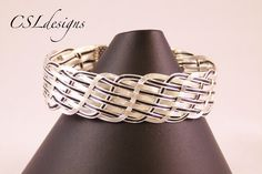 In this tutorial I show you how to make a close wire woven bracelet. Please feel free to give it a go yourself and I hope you enjoy. This is my original desi...