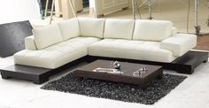 Modern Black and White Sectional L Shaped Sofa Design Ideas for Living Room Furniture with Elegant Dark Wood Sofa Frame that have Low Style Legs also Contemporary White Leather Materials Seat Cushions