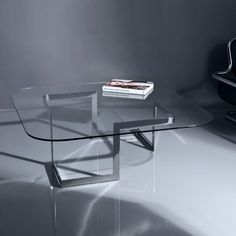 Walter, coffee table. Glass top and polished stainless steel base. Designed By:  Ardeco Studio~Georges Amatoury. To be ordered online through www.levantania.com