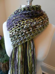 Wow!  I love this.  sewstacy shop on etsy.  Crochet Scarf - The Teanna Scarf -  Greens and Purples, Hand Knit Scarf, Unisex Scarf, Fringe Edge Fall Fashion Scarf. $32.00, via Etsy.