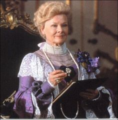 Lady Bracknell portrays a complex woman with ideals from the Victoria Age.  Though it appears that morality is what defines her, she is more motivated by maintaining the status quo and assuring that the social classes do not intermix. Also, Schmidt points out that Wilde was addressing the tension that existed because women's roles were changing.  Lady Bracknell's leadership and strength are highlighted and her husband is only mentioned in passing.
