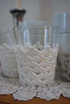 Tea Glass Covers free crochet pattern (in extremely small type) on Mama's Kram (site is in  German and does not translate well - I'm keeing it because I love the idea) at http://mamaskram.blogspot.com/2009/09/teeglaser-und-kaffeebecher.html