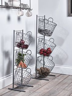 Made from iron wirework with a grey powder coated finish, each set of Tier Baskets include three round baskets with two matching wirework handles all set upon a strong frame. Each basket can be removed from the frame, making them ideal for collection vegetables from your allotment or local farm shop before popping them on the stand for storage. Available in two sizes, our Wire Tier Baskets are essential for storing anything from fruit and vegetables to tea towels and cloths in your kitchen.