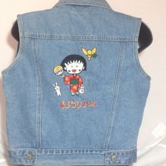 "True Vintage Kimono Girl Denim Vest Fits Small XS TRUE Vintage 100 pct cotton light blue denim vest. The design is of a kimono girl, bunny and some other animal with the number 33 and Japanese writing.  Very nice details. It is nicely faded and soft. The antiqued Silvertone buttons say BAIT and have a dog logo. In the neck it says ""TAG since 1896"" It measures 34"" across the chest and is 17""  long (cropped) so it is best for a size SMALL or XS . I believe it to be cropped. Please compare the…"