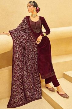 Immerse yourself in the world of the elegant and traditional world by wearing this dark maroon velvet trouser suit which will make all the goddesses of love and beauty to write you for your advice. This u neck and full sleeve wedding wear dress designed using stonework. Dupatta embellished in thread and stonework. #trousersuit #salwarkameez #malaysia #Indianwear #Indiandresses #andaazfashion Indian Attire, Indian Ethnic Wear, Kurta Cotton, Sharara Suit, Salwar Kameez, Velvet Pants, Trouser Suits, How To Dye Fabric, Festival Wear