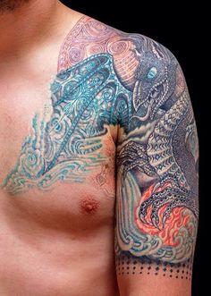 Geometric dragon Tüskevàr tattoo art