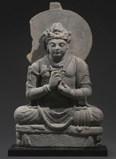 A Grey Schist Figure of a Seated Bodhisattva - Ancient region of Gandhara, Kushan period, 3rd/4th century