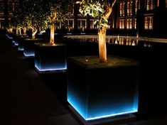 The LED lighting of the giant glass-sided planters that elegantly frame the entrance to the Victoria and Albert Museum in Kensington, London, are designed to create the appearance of a static water feature. The blue glow emanating from the evenly spaced p Backyard Lighting, Outdoor Lighting, Lighting Ideas, Outdoor Landscaping, Front Yard Landscaping, Landscaping Ideas, Landscape Lighting Kits, Contemporary Landscape Lighting, Landscape Lighting Transformer