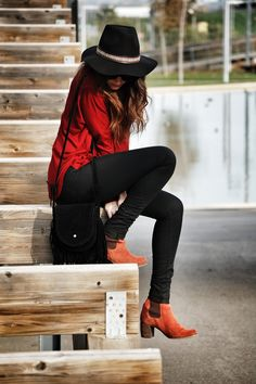 loose red top, black leggings, floppy hat and killer booties