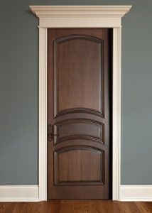 Wood door with white trim.