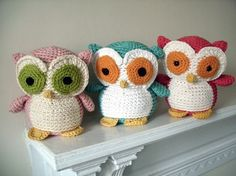 Colorful Crochet Owls. Pink with Olive Eyes, Turquoise with Orange Eyes, Red with Orange Eyes.