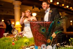 Bride & Groom Eating Cake at the Alice in Wonderland Wedding at the Hotel Boulderado (Photo by Frances Photography)
