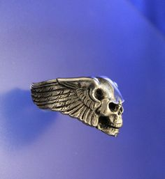 Winged Skull Handcrafted Ring in Solid Sterling Silver (STERLING is stamped inside shank). Size 11. This is a large substantial thick and heavy
