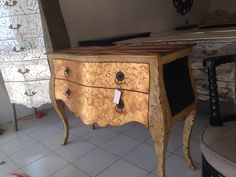 commode broken gold and black finishing. Have two drawer