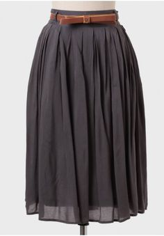 "We're swooning over this adorable charcoal midi skirt perfected with a removable tan bow belt with yellow piping. Finished with pleating and a hidden side zipper closure, this skirt is a versatile wardrobe staple that can be worn year round. Fully lined. 100% Rayon. Imported. 26.5"" length from top of waist 26"". All measurements taken from a size small."
