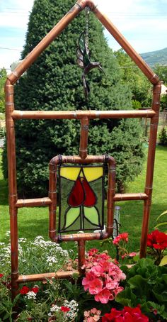 Copper trellis with stained glass panel.