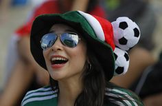 A Mexico soccer fan reacts as she watches her team's World Cup match with Cameroon on a screen inside the FIFA Fan fest area on Copacabana beach in Rio de Janeiro, Brazil, Friday, June (AP P Soccer World, Soccer Fans, World Cup 2014, Fifa World Cup, Premier League, Brazil Wallpaper, Mexico Soccer, World Cup Match, Copacabana Beach