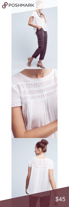 """NWT Anthropologie + Meadow rue Galicia Eyelet top Brand new With tags Anthropologie Galicia Eyelet top size Medium. Eyelet accents give this boho-inspired piece a timeless finish. Designed by Meadow Rue.  Cotton, modal Keyhole back Pullover styling Machine wash Imported Dimensions Regular: 22.75""""L Line across tag to avoid store returns. Anthropologie Tops"""