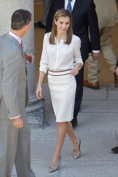 Queen Letizia ... in an Hugo Boss white outfit with Carolina Herrera snake shoes