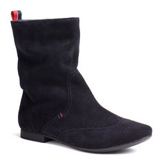 Sleek and stylish ankle boot in a suede upper. Heel tab for pull-on wear in Tommy Hilfiger signature colours. Accent seams throughout add definition. Tommy Hilfiger twin stitch on the outside. Unlined with leather sock lining. Rubber outsole with 1cm heel.