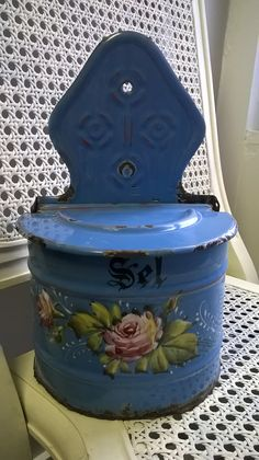In good shabby condition, with chipping in the enamel with some rusting areas, time worn distressed, typical for these enamelware pieces to have. Beautiful country, cottage, chic and shabby Bold country blue coloring. Gorgeous hand painted flowers. Still very functional for your shabby, French country or farmhouse chic kitchen. The bottom is rusted through the fine seem, no longer hold fine grained dry goods, however this piece can be used as a decorative piece as well as a hide away to…