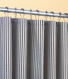 Ticking Stripes Shower Curtain- comes in a variety of colors including navy, light blue, natural and sage green stripes